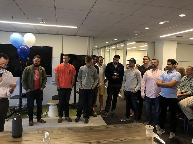 agency sales team accepting their award